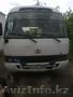Китайский автобус FAW и MUDAN